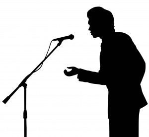 man silhouette speech to microphone